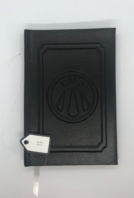 Black journal with a raised design on the cover.