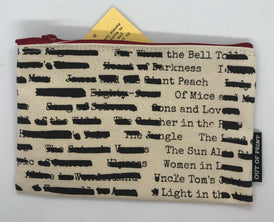 Tan canvas pencil case with banned book titles with some redacted.