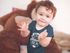 products/baby-boy-clapping-sitting-down-wearing-a-onesie-with-a-monkey-plush-in-the-background-mockup-a14022.png