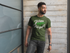 products/front-view-t-shirt-mockup-featuring-a-man-with-a-beard-against-a-concrete-wall-and-a-window-21352_ffc2a964-8102-4e2d-96c3-c8a05f850c81.png