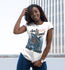 products/happy-young-girl-wearing-a-round-neck-tee-mockup-while-against-a-city-building-a16046.png