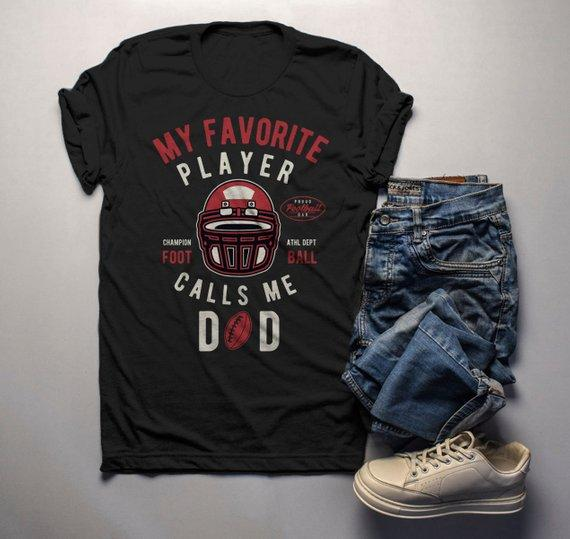 fb7dd9c6448 Men s Football Dad T Shirt My Favorite Player Calls Me Graphic Tee Football  Shirts Dad Gift
