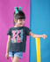 products/little-girl-wearing-a-t-shirt-mockup-a-hair-ribbon-and-rain-boots-in-a-bicolor-room-a19475.png