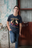 products/mockup-of-a-man-wearing-a-t-shirt-while-leaning-against-an-old-wall-25292.png