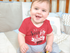 products/mockup-of-a-smiling-baby-boy-sitting-in-his-crib-while-wearing-a-onesie-a13959.png