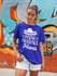 products/mockup-of-a-woman-wearing-a-unisex-t-shirt-in-front-of-graffiti-22788.png