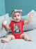 products/onesie-mockup-featuring-a-baby-girl-with-toy-blocks-m923.png