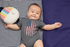 products/onesie-mockup-of-a-baby-boy-lying-on-a-blanket-30016.png