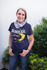 products/senior-woman-wearing-a-round-neck-tee-mockup-against-plants-a20667.png