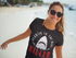 products/smiling-lovely-woman-wearing-a-t-shirt-mockup-and-sunglasses-at-the-beach-a12725.png
