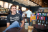products/smiling-white-man-wearing-a-t-shirt-mockup-at-a-coffee-shop-a20315.png