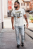 products/t-shirt-mockup-of-a-bearded-man-walking-on-a-concrete-ramp-1024-el.png
