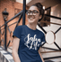 products/t-shirt-mockup-of-a-curly-haired-girl-with-glasses-25802.png