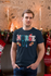products/t-shirt-mockup-of-a-man-in-a-cozy-christmas-setting-with-candles-30173.png