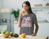 products/t-shirt-mockup-of-a-woman-drinking-orange-juice-in-the-kitchen-36341-r-el2.png