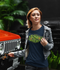 products/t-shirt-mockup-of-a-young-woman-walking-by-an-all-terrain-truck-412-el.png