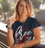 products/tee-mockup-featuring-a-blonde-young-woman-near-some-palm-trees-26749.png