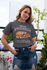 products/tee-mockup-of-a-girl-with-a-coy-smile-by-a-balcony-26628_2c3edf52-0261-4160-bab3-d3cc6ccbe692.png