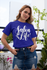 products/tee-mockup-of-a-girl-with-a-coy-smile-by-a-balcony-26628_3bccd394-9beb-44c9-8ea0-049e7cb6da53.png