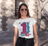 products/tee-mockup-of-a-woman-with-sunglasses-walking-around-downtown-26351.png