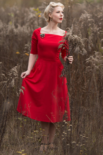 Robe rouge avec poches