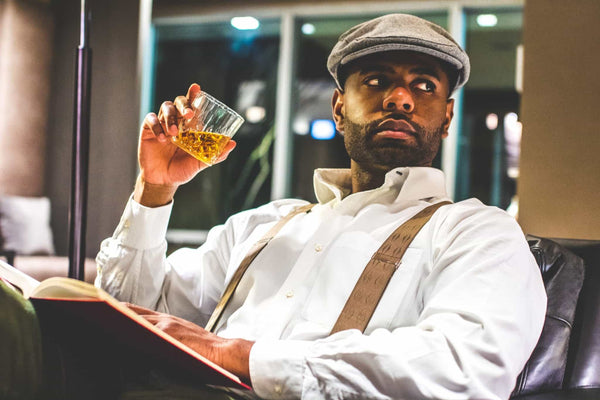 Business man with suspenders and whiskey
