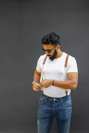 Suspenders and a tshirt go very well together. A white t-shirt matches dark suspenders, a black t-shirt suits white suspenders or braces very well in Europe fashion.