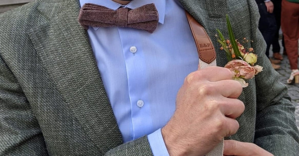 Unique wedding outfit with personalised suspenders. The groom looks magnificent in his personal bretelles.