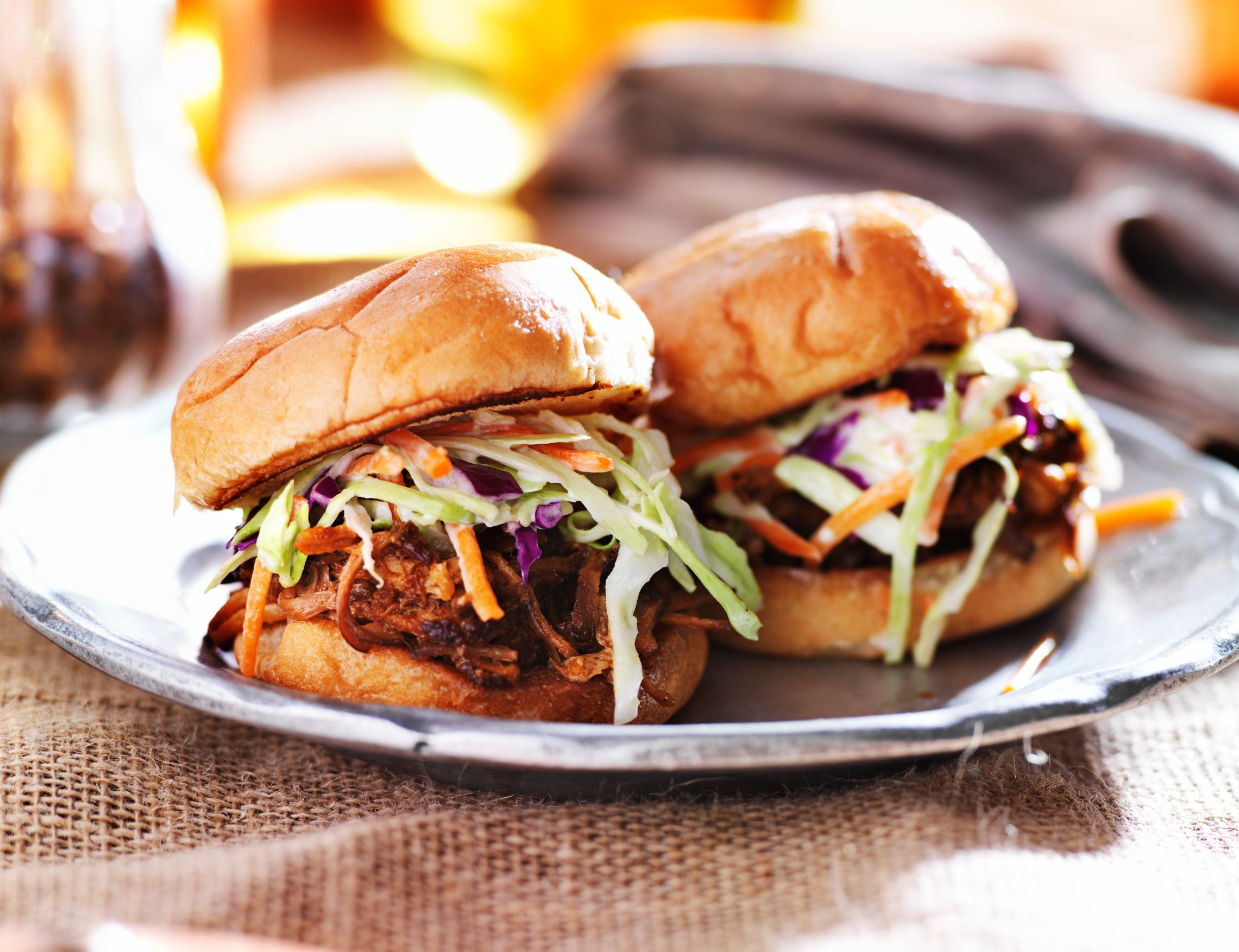 pulled pork sandwiches on a plate