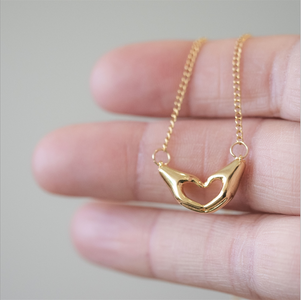 You added Love You Heart & Hands Necklace to your cart.