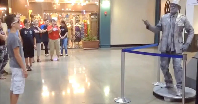 Teen Challenges 'Statue' To Dance-Off And Crowd Gathers To Watch In Awe
