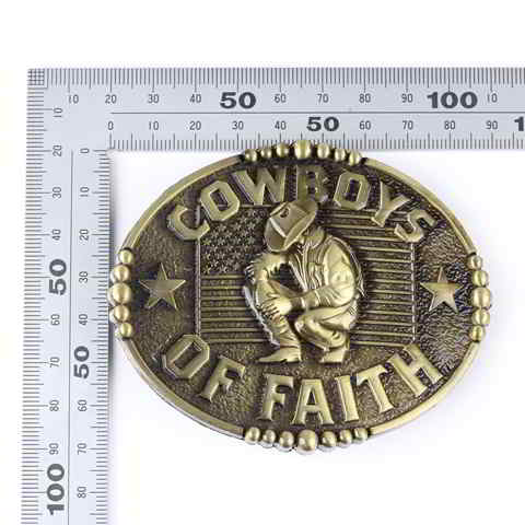 Buckle featuring a praying cowboy and the words Cowboys of Faith.