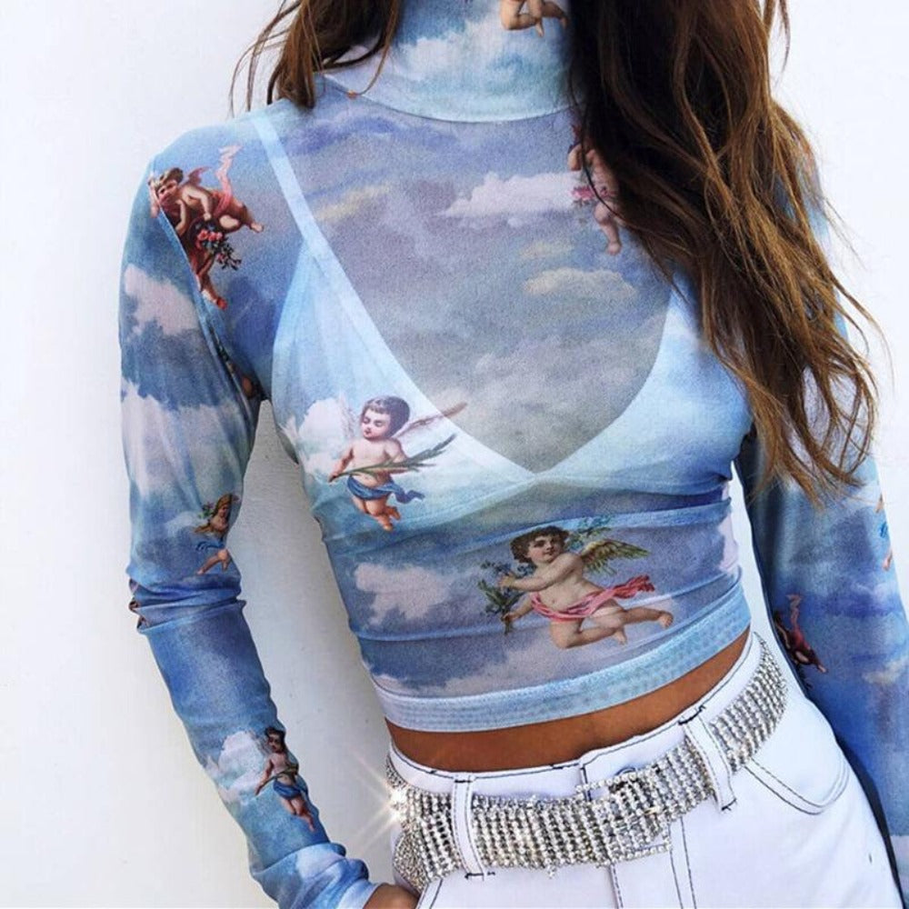 standing woman wearing blue Long Sleeve angels designs-white pants