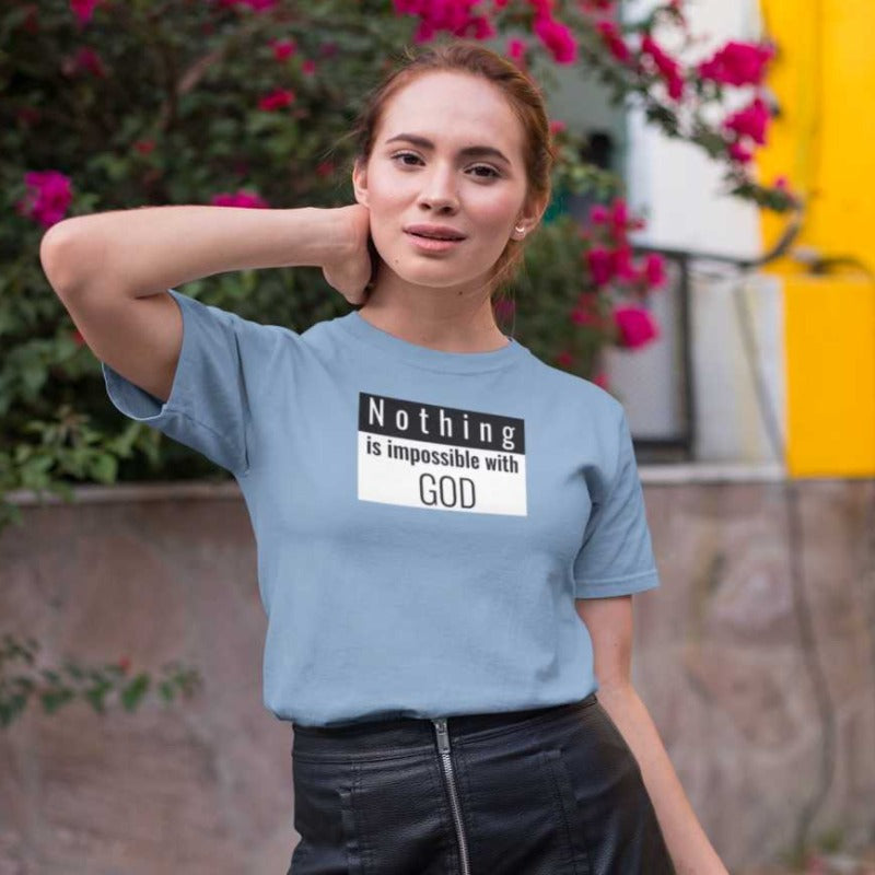 women with sky blue color T-shirt Nothing is impossible with God