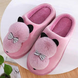 chausson chat pompon rose
