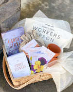 Our gardeners gift set is a beautiful gift for any garden lover with pots, soil, gloves, an apron, and seeds it has everything to grow your own edible flowers