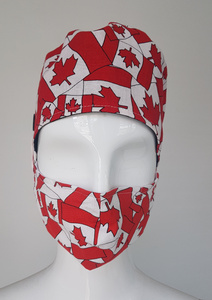 Canada Flag Scrub Cap.  Ear saver feature to attach mask ear loops.   Made with 100% Cotton for comfort.  Designed and Made in Canada. Canada Flag Pattern one side Reversible all Black other side.  Tie back straps in original colors on the back.  Coordinate with Canada Flag or Black Masks.