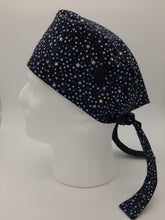 Load image into Gallery viewer, Stars + Glitter Print Scrub Cap Reversible to solid Black color with Red Maple Leaf Patch