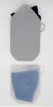 Load image into Gallery viewer, Translucent Face Mask Pouch. Made of Flexible Food Grade Silicone. Washable, microwaveable, easy to clean. Perfect for keeping Face Masks. 14x11x1cm. Translucent or Grey color. Loop for hanging to bag or backpack.