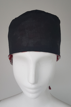 Load image into Gallery viewer, Canada Flag Scrub Cap.  Ear saver feature to attach mask ear loops.   Made with 100% Cotton for comfort.  Designed and Made in Canada. Canada Flag Pattern one side Reversible all Black other side.  Tie back straps in original colors on the back.  Coordinate with Canada Flag or Black Masks.