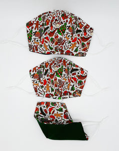 Our exclusive collection of Christmas Masks by popular demand.  All our Christmas Masks are Reversible so they can continue to be used after the holiday season.  Nose Wire, Adjustable Ear loops, filter pocket between two layers of 100% cotton fabric.  3rd layer non-woven polypropylene fitted filter available to fit in OCanadaMasks filter pocket.  Machine washable + dryable.