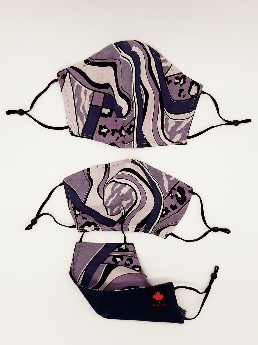 Back to School + Work Collection.   Print one side, solid color other side, reversible for versatility. Fashionable Face Covers that are functional, comfortable + Beautiful. If you have to wear a mask, wear one you LOVE!  Designed + Made in Canada.  Nose wire, adjustable ear loops, two layers of 100% cotton for comfort with integrate filter pocket between the two layer cotton layers.-C