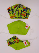 Load image into Gallery viewer, Back to School + Work Collection.   Print one side, solid color other side, reversible for versatility. Fashionable Face Covers that are functional, comfortable + Beautiful. If you have to wear a mask, wear one you LOVE!  Designed + Made in Canada.  Nose wire, adjustable ear loops, two layers of 100% cotton for comfort with integrate filter pocket between the two layer cotton layers.