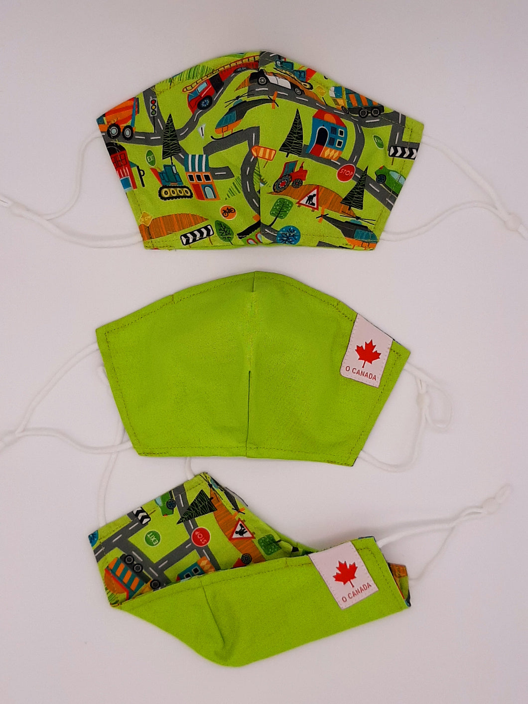 Back to School + Work Collection.   Print one side, solid color other side, reversible for versatility. Fashionable Face Covers that are functional, comfortable + Beautiful. If you have to wear a mask, wear one you LOVE!  Designed + Made in Canada.  Nose wire, adjustable ear loops, two layers of 100% cotton for comfort with integrate filter pocket between the two layer cotton layers.