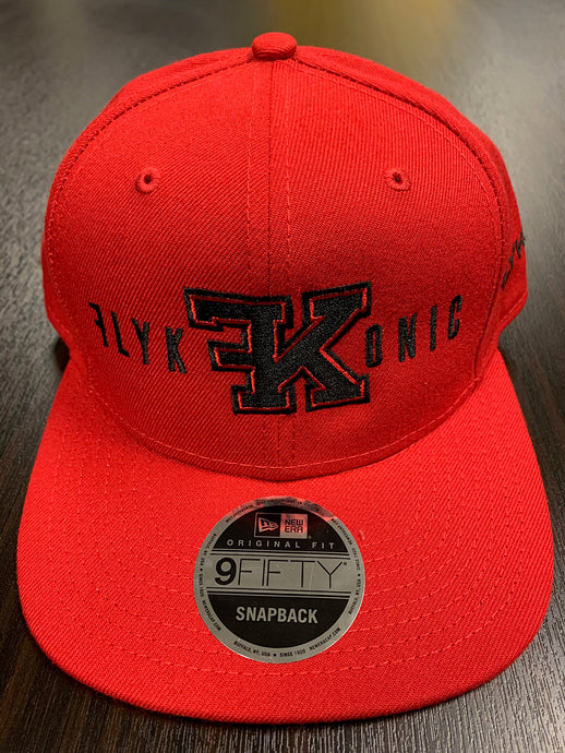 Flykonic FK Snapback on red hat with black stitching