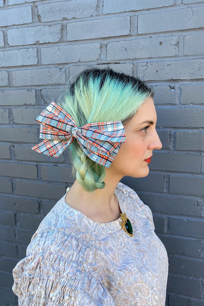 retro style vintage plaid patterned pastel blue orange white hairbow hair bow clip in on model
