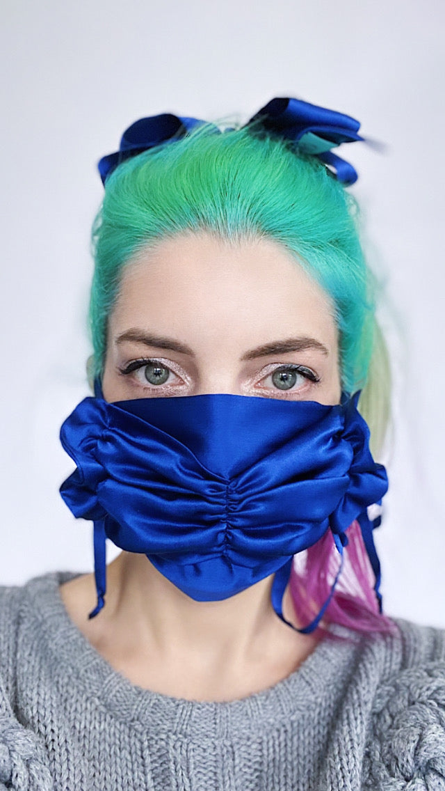 Luxurious navy blue silk charmeuse ruched ruffle tie on face mask.