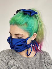 Luxurious navy blue silk charmeuse ruched ruffle tie on face mask with matching hair bow.