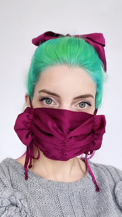 Luxurious burgundy silk charmeuse ruched ruffle tie on face mask.