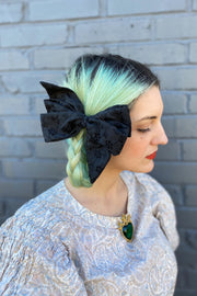 Black cotton floral eyelet lace lolita style hair bow.